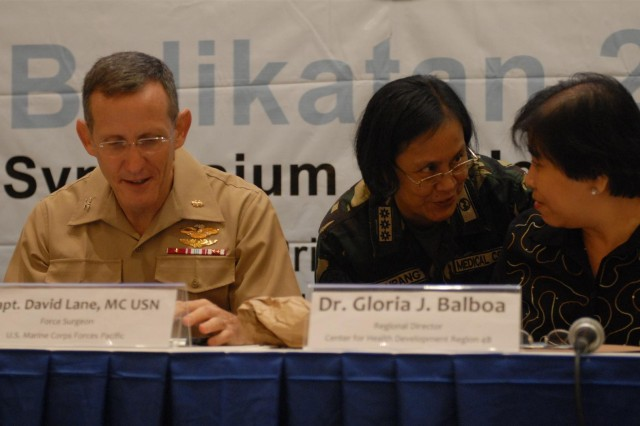 "PUERTO PRINCESA, Palawan, Republic of the Philippines "" Philippine Col. Maria Imelda Perez Dalupang, executive officer, Office of the Surgeon General shares a moment's conversation with Philippine Dr. Gloria Balboa, regional director, Center for Health Development, Region IV-B and on their right is U.S. Navy Capt. David A. Lane, force surgeon, U.S. Marine Corps Pacific, as they prepare for a medical symposium that brought Philippine and U.S. medical and veterinary professionals together to exchange knowledge and ideas in Puerto Princesa, Palawan, Republic of the Philippines on April 10.  The medical symposium is part of the humanitarian civic assistance (HCA) portion of Exercise Balikatan 2012 (BK12), which officially starts on April 16, with the HCA portion of the exercise that started earlier on March 12 with engineering projects which consisted of building two-room classrooms at five schools within the Puerto Princesa area. The construction projects are now over 50 percent complete and are expected to be completed by April 27, 2012.  BK12, in its 28th iteration, is an annual bilateral training exercise between the Armed Forces of the Philippines and the U.S. military to enhance interoperability between the two partner nations. (U.S. Army Photo by 1st Lt. Ray K. Ragan, Combined Joint Civil-Military Operations Task Force Public Affairs Officer)"