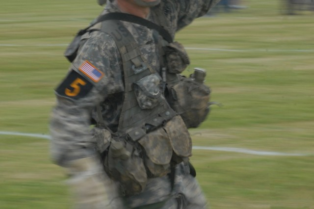 A competitor from Team 5, of the 1st Infantry Division, carries an ammo can during the Leadership Challenge on day three of the 2012 Best Ranger Competition at York Field on Fort Benning, Ga., April 15, 2012. The 34 remaining Best Ranger Competition teams fast-roped into the challenge from a UH-60 Black Hawk helicopter.