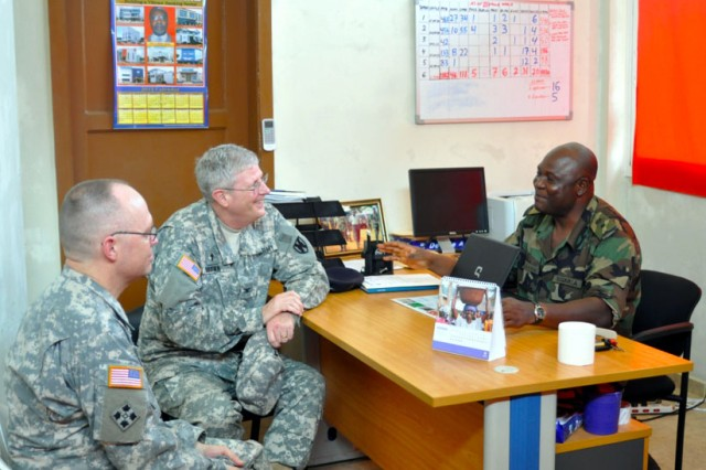 Chap. (Col.) Gary Brown (center) and Chap. (Maj.) Allen Staley (left) talk with Lt. Col. A.G. Audu (right), Commander of the Armed Forces of Liberia 23rd Infantry Brigade, during a visit to Monrovia, Liberia, for a Chaplain Professionalization Seminar. Brown and Staley used their previous visit to Monrovia to relate experiences to the local chaplains to help them develop their roles in the community.