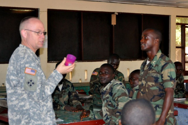 U.S. Army Africa Chaplain (Maj.) Allen Staley (left), demonstrates a practical learning exercise to help Armed Forces Liberia Chaplains with their Army problem solving skills.