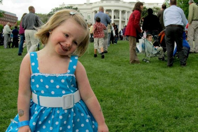 Lyra Douglas, 2, enjoys her first egg roll on the White House south lawn April 9.