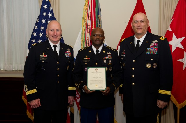 Gen. Raymond Odierno (Right), the chief of staff of the U.S. Army, and Gen. Robert Cone (Left), the commanding general of the U.S. Army's Training and Doctrine Command, stand with Master Sgt. Keith Ford, a U.S. Army Criminal Investigation Command special agent assigned to the Protective Service Battalion, 701st Military Police Group (CID), during his promotion ceremony at the Pentagon, Mar. 19, 2012. Ford is currently serving as Gen. Odierno's Protective Service Officer and is directly responsible for his personal protection.