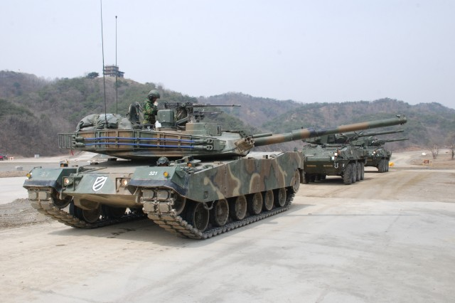 """RODRIGUEZ TRAINING RANGE, South Korea - A K-1 Tank of the 3rd Tank Company, 56th Battalion, 9th Regiment, and two Stryker Mobil Gun Systems from the 1st Battalion, 21st Infantry Regiment, """"Gimlets,"""" 25th Infantry Division, prepare to execute a defensive live-fire training exercise, April 12, here. The training event was part of Foal Eagle 2012, an annual combined training exercise between the U.S. and Republic of Korea armies, which focuses on strengthening partnerships and unit interoperability of war-fighting skills."""