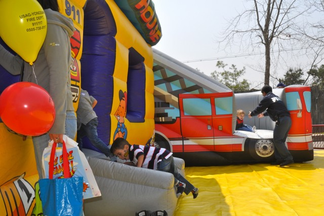 Kids play in a jump house at CYSS fun fair, April 14. U.S. Army Garrison Yongsan Child Youth Schools and Services provided a fun day to celebrate the month of military children.