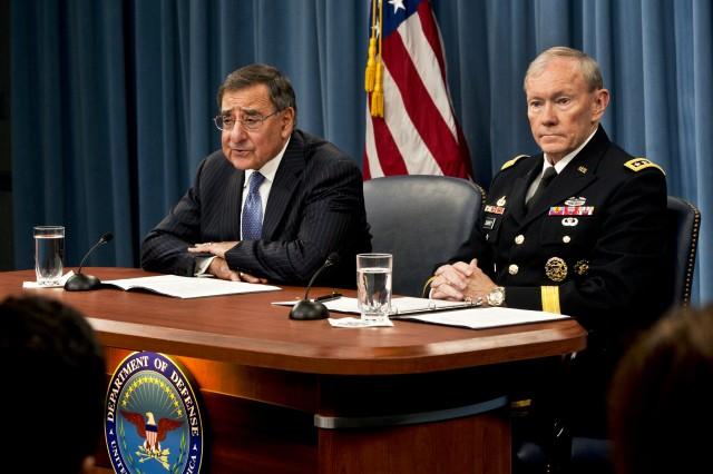 Defense Secretary Leon E. Panetta briefs the press while Gen. Martin E. Dempsey, chairman of the Joint Chiefs of Staff, listens at the Pentagon, April 16, 2012.