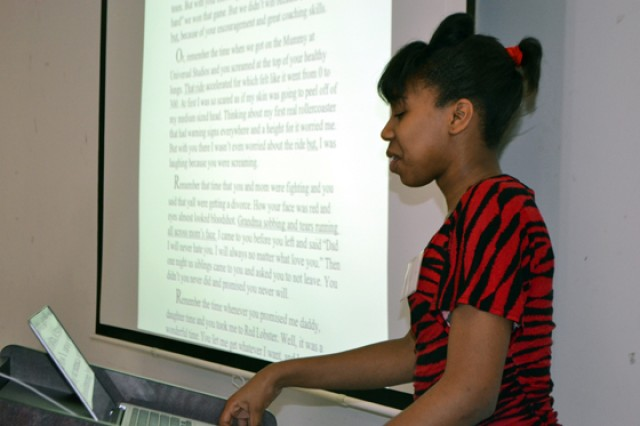 Kiara Jackson, a participant in the A Backpack Journalist program, presents a thank you letter for her father, Chad Jackson, to other students during a weekend workshop in March 2012.