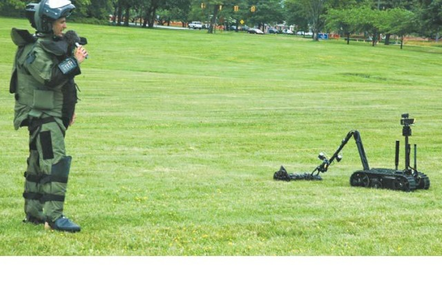 At last year's Armed Forces Day, Staff Sgt. Frank Rodriguez, 22d Chemical Battalion (Technical Escort) Explosive Ordnance Disposal technician, demonstrated how a Talon robot manipulates a suspicious package.