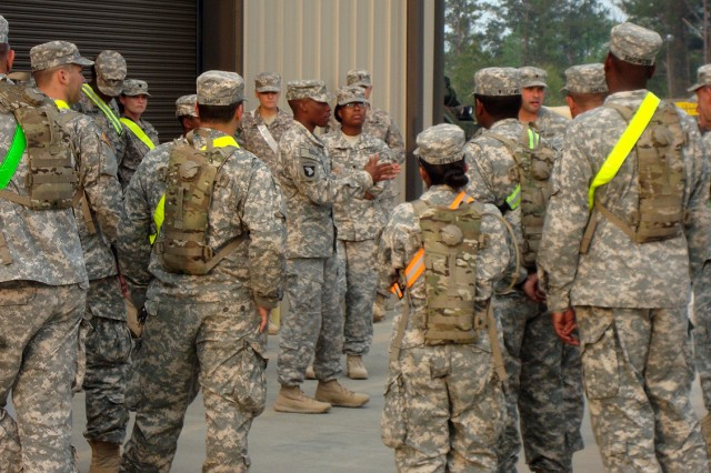 CAMP SHELBY, MISSISSIPPI--Sgt. Gene Taylor (center), 227th Quartermaster Company, gives 427th Brigade Support Battalion Soldiers on-the-spot feedback during Redistribution Property Assistance Team Academy instruction, March 19, 2012, at Camp Shelby, Miss.