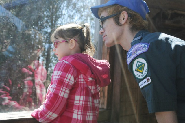 Joe Andrus, 17, and his little sister, Aimee, 2, look at owls during a recent visit to the New York State Zoo at Thompson Park in Watertown. Joe is working on his Eagle Scout project at the zoo.