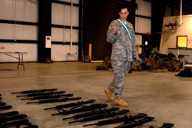 CAMP SHELBY, Miss. -- Sgt. Angelique Mann, 427th Brigade Support Battalion (BSB), counts dummy rifles as part of the special base-closure training she and other BSB Soldiers received in March. Soldiers of the battalion's B Company and Headquarters and Headquarters Company left here for Afghanistan on April 6. The Soldiers will have to account for millions of dollars of equipment, such as weapons, as they close bases. The battalion belongs to the 27th Infantry Brigade Combat Team. Brigade Soldiers have already deployed from here to Kuwait, and other brigade Soldiers are here preparing to deploy.
