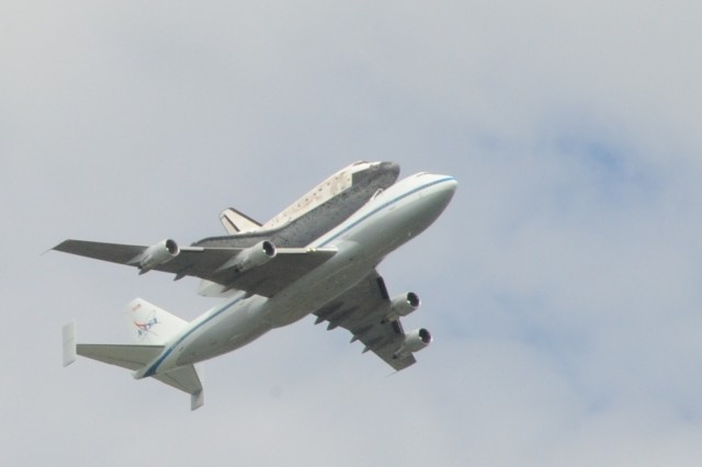 Space Shuttle Discovery flies over the historic Fort Lesley J. McNair on her final voyage April 17, 2012.  Discovery is atop NASA's converted 747 Shuttle Carrier Aircraft at approximately 10 a.m. during one of its loops around the nation's capital before its landing at Dulles Airport around 11 a.m.