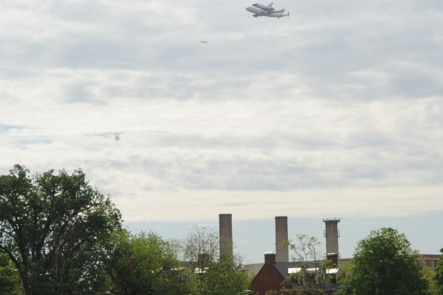 Space Shuttle Discovery flies over enlisted Soldiers housing at historic Fort Lesley J. McNair on her final voyage, April 17, 2012.  Discovery is seen atop NASA's converted 747 Shuttle Carrier Aircraft at approximately 10 a.m. during one of its loops around the nation's capital before its landing at Dulles Airport around 11 a.m.