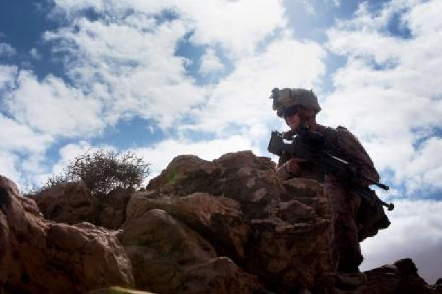 A Marine from 81 mm mortar platoon, Weapons Company, 1st Battalion, 2nd Marine Regiment, Battalion Landing Team, 24th Marine Expeditionary Unit provides security during the team's extraction after a quick-strike, indirect-fire mission on a simulated enemy fuel convoy here, April 9, during Exercise Africa Lion 2012. AL-12 is a U.S. African Command-sponsored, Marine Forces Africa-led exercise involving various types of training including command post, live-fire and maneuvering, peace keeping operations, an intelligence capacity building seminar, aerial refueling/low-level flight training, as well as medical and dental assistance projects. The annual exercise is designed to improve interoperability and mutual understanding of each nation's military tactics, techniques and procedures.