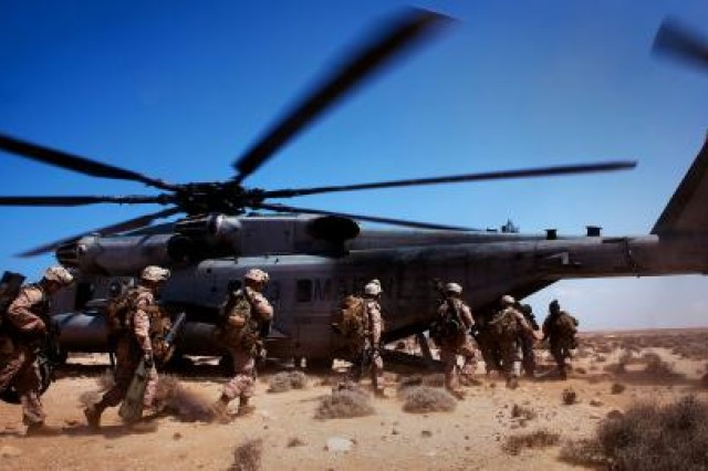Marines from 81 mm mortar platoon, Weapons Company, 1st Battalion, 2nd Marine Regiment, Battalion Landing Team, 24th Marine Expeditionary Unit board a helicopter after executing a quick-strike, indirect-fire mission on a simulated enemy fuel convoy here, April 9, during Exercise Africa Lion 2012. AL-12 is a U.S. African Command-sponsored, Marine Forces Africa-led exercise involving various types of training including command post, live-fire and maneuvering, peace keeping operations, an intelligence capacity building seminar, aerial refueling/low-level flight training, as well as medical and dental assistance projects. The annual exercise is designed to improve interoperability and mutual understanding of each nation's military tactics, techniques and procedures.