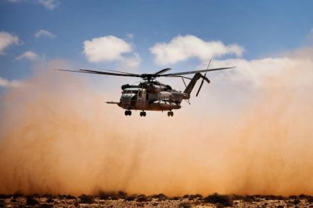A CH-53E Super Stallion helicopter transports Marines from 81 mm mortar platoon, Weapons Company, 1st Battalion, 2nd Marine Regiment, Battalion Landing Team, 24th Marine Expeditionary Unit to the USS Iwo Jima after they executed a quick-strike, indirect-fire mission on a simulated enemy fuel convoy here, April 9, during Exercise Africa Lion 2012. AL-12 is a U.S. African Command-sponsored, Marine Forces Africa-led exercise involving various types of training including command post, live-fire and maneuvering, peace keeping operations, an intelligence capacity building seminar, aerial refueling/low-level flight training, as well as medical and dental assistance projects. The annual exercise is designed to improve interoperability and mutual understanding of each nation's military tactics, techniques and procedures.