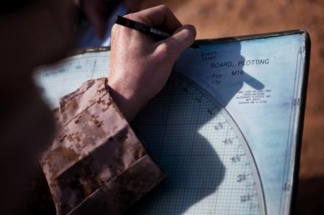 A Marine from 81mm mortar platoon, Weapons Company, 1st Battalion, 2nd Marine Regiment, Battalion Landing Team, 24th Marine Expeditionary Unit plots the fire direction information for the gun line during a quick-strike, indirect-fire mission on a simulated enemy fuel convoy here April 9 during Exercise Africa Lion 2012. AL-12 is a U.S. African Command-sponsored, Marine Forces Africa-led exercise involving various types of training including command post, live-fire and maneuvering, peace keeping operations, an intelligence capacity building seminar, aerial refueling/low-level flight training, as well as medical and dental assistance projects. The annual exercise is designed to improve interoperability and mutual understanding of each nation's military tactics, techniques and procedures.