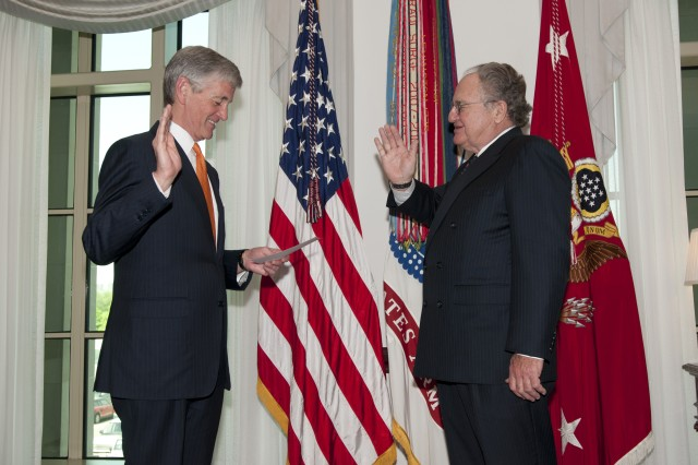 Secretary of the Army John McHugh administers the oath to Thomas Kershaw, who became a Civilian Aide to the Secretary of the Army for Massachusetts during a ceremony at the Pentagon, April 16, 2012.  CASAs are usually business or civic leaders who possess a keen interest in the welfare of the Army and their communities, serving a two-year term without compensation.   (U.S. Army Photo by Staff Sgt. Bernardo Fuller)