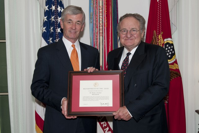 Secretary of the Army John McHugh presents Thomas Kershaw with his certificate of appointment as the Civilian Aide to the Secretary of the Army for Massachusetts following the swearing-in ceremony at the Pentagon, April 16, 2012. CASAs are usually business or civic leaders who possess a keen interest in the welfare of the Army and their communities, serving a two-year term without compensation.   (U.S. Army Photo by Staff Sgt. Bernardo Fuller)
