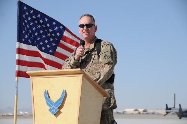 Air Force Col. Benjamin Wham, Afghanistan Engineer District South commander, addresses the attendees at the strategic and tactical ramp turnover ceremony on Kandahar Airfield,Afghanistan.