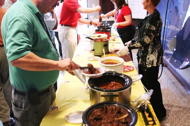 One of two tables filled with chili for the U.S. Army Space and Missile Defense Command/Army Forces Strategic Command's chili cook off April 17 to raise funds for Army Emergency Relief. Twleve pots were in the contest and another three were simply donated.