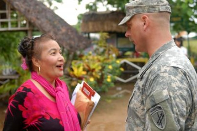 """Cynthia C. Castro, barangay captain, Inagawan Sub Colony, Puerto Princesa City discusses coordination with U.S. Army Capt. Kenneth """"Josh"""" E. Hughes, civil affairs team leader, Civil Affairs Team-South, Combined Joint Civil-Military Operations Task Force before a medical and veterinary outreach clinic here on April 11. The medical and veterinary outreach clinic is part of the humanitarian civic assistance (HCA) portion of Exercise Balikatan 2012 (BK12), which officially started on April 16. The HCA portion of the exercise started March 12 with engineering projects, consisting of building two-room classrooms at five schools within the Puerto Princesa area. The construction projects are now over 70 percent complete and are expected to be completed by April 27, 2012.  BK12, in its 28th iteration, is an annual bilateral training exercise between the Armed Forces of the Philippines and the U.S. military to enhance interoperability between the two partner nations."""