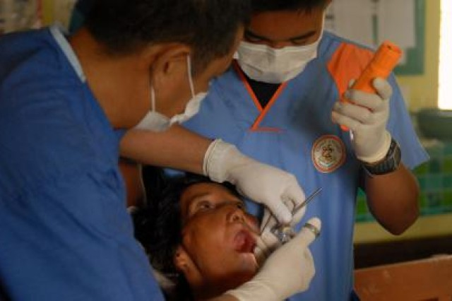 Philippine Coast Guard dentists perform tooth extractions during a medical and veterinary outreach clinic in Puerto Princesa, Palawan, Republic of the Philippines on April 11. The medical and veterinary outreach clinic is part of the humanitarian civic assistance (HCA) portion of Exercise Balikatan 2012 (BK12), which officially started on April 16. The HCA portion of the exercise started March 12 with engineering projects, consisting of building two-room classrooms at five schools within the Puerto Princesa area. The construction projects are now over 70 percent complete and are expected to be completed by April 27, 2012.  BK12, in its 28th iteration, is an annual bilateral training exercise between the Armed Forces of the Philippines and the U.S. military to enhance interoperability between the two partner nations.