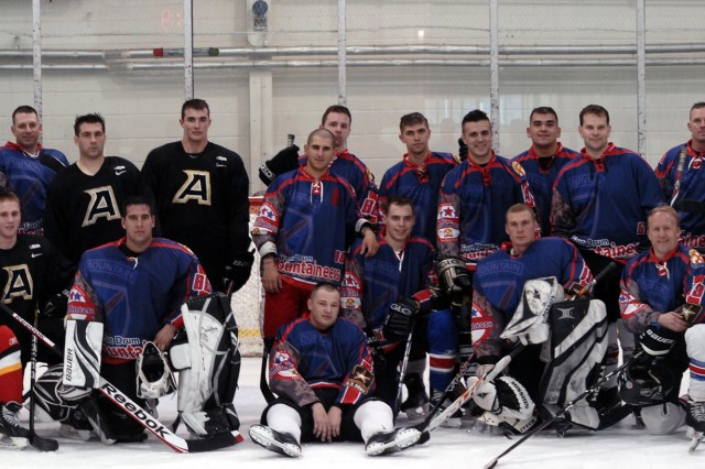 Members of the Fort Drum Hockey Club pose for a picture after a game in Canada versus the Royal Military College of Canada in Kingston. Maj. Gen. Mark A. Milley, right, Fort Drum and 10th Mountain Division (LI) commander, played as a guest on the team during the Friday game at Constantine Arena.