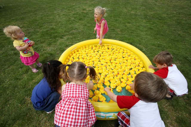 Children play at the American Water Enterprises duck display at the Earth Day event. Youngsters also enjoyed a terrapins exhibit and a display of live honeybees.