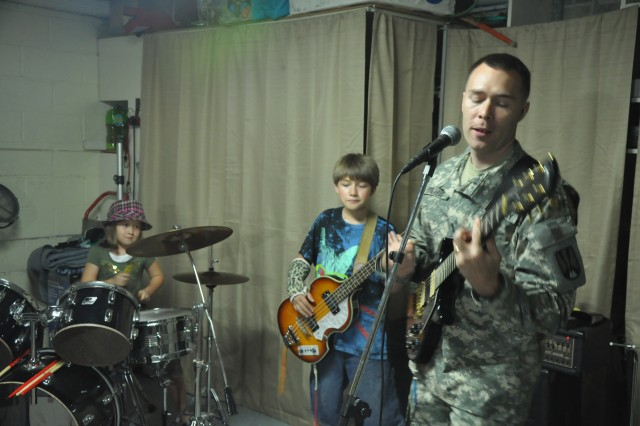William Edwards, right, practices with Eddie's Experiment, a band that includes daughter Elena, left, and son Jacob.
