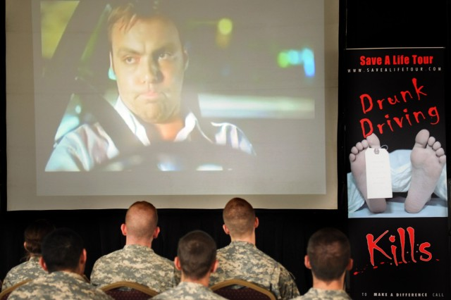 Members of the 742nd Military Intelligence Battalion watch a graphic video of the consequences of drunk driving during the National Save-A-Life Tour at McGill Training Center. The traveling tour promotes drinking responsibly.