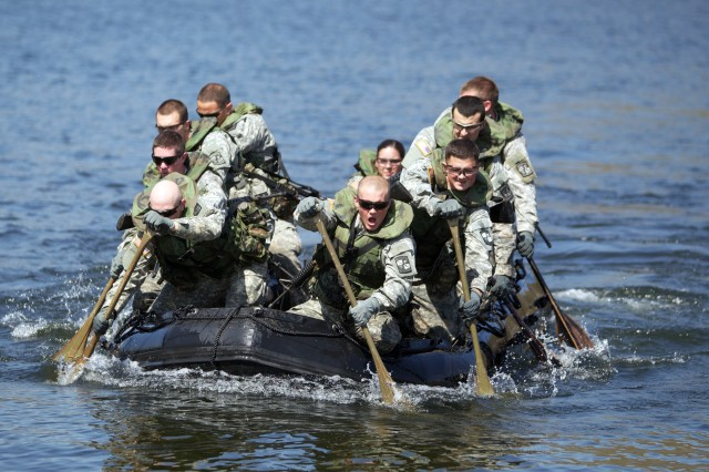 Members of The Citadel paddle their boat in a waterborne operations  practice run Thursday in a pond near where the Sandhurst Competition begins Friday in West Point, N.Y.