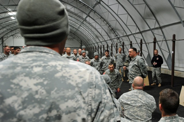 "At 4:07 a.m., Brig. Gen. Peter ""Duke"" DeLuca, Army Engineer School commandant, gives a final pep talk to the 76 contestants vying for the title of 2012 Best Sapper that launched April 19, 2012, at Fort Leonard Wood, Mo."