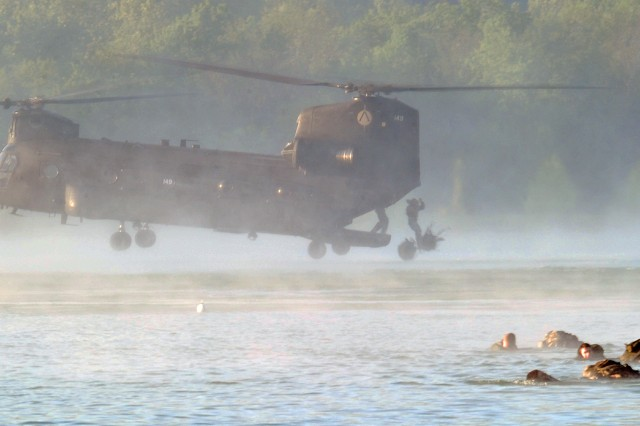 As a CH-47Chinook kicks up a powerful prop wash on a fog-covered lake, Best Sapper competitors tethered to their rucksacks leap from the chopper's ramp into 66-degree water for the 20-minute swim to shore. Thirty-eight teams of two are vying for the top spot in the Army Engineer School annual challenge at Fort Leonard Wood, Mo.