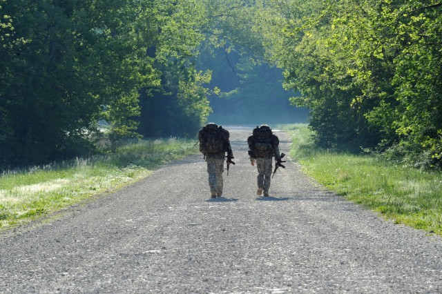 Following the helocast, Soldiers in the Best Sapper competition change into dry uniforms, shoulder their rucks filled with wet clothes, grab their rubber M-4 carbines and hit the road. Best Sapper is sponsored annually by the Army Engineer School at Fort Leonard Wood, Mo.