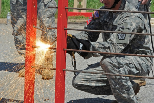 A Best Sapper contestant slices through 10 half-inch-diameter rebar rods in the thermal breaching exercise. The 2012 Best Sapper competition kicked off April 19, 2012, at Fort Leonard Wood, Mo.