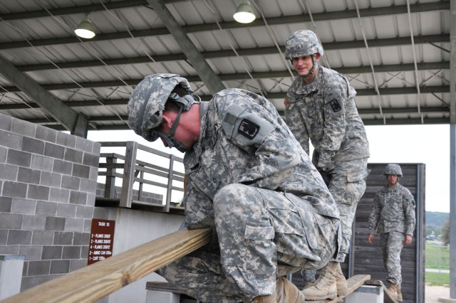 Soldiers of the 717th Military Intelligence Battalion attempt to negotiate an obstacle during the Leadership Reaction Course as part of the battalion's overall Junior Leader Development Course. The event took place on Camp Bullis March 27. (U.S. Army photo by Sgt. Qaasim Jenkins)