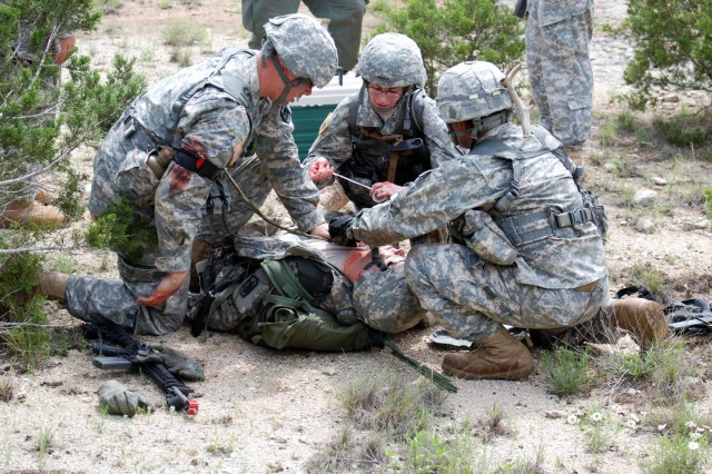 Soldiers of the 717th Military Intelligence Battalion treat a simulated casualty during the capstone exercise of their Junior Leader Development Course. This exercise took place on Camp Bullis March 29. (U.S. Army photo by Gregory Ripps)