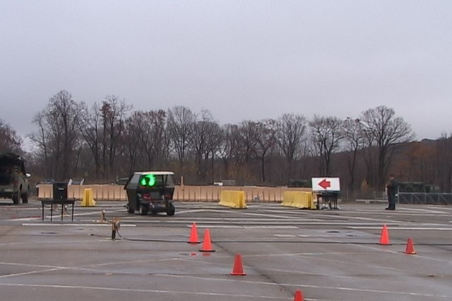 PICATINNY ARSENAL, N.J. - A vehicle used in an experiment negotiates a test course while a green laser is directed at the windshield.