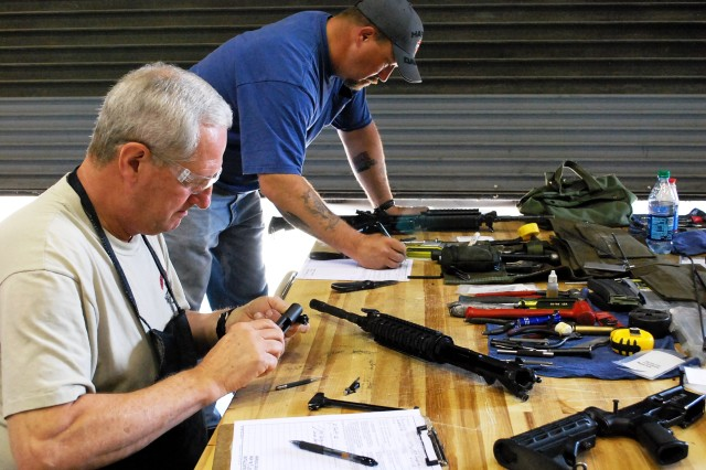 Contracted employees work on M4 Carbines April 10 at Fort Hood Texas. (Photo by Jon Connor, ASC Public Affairs)