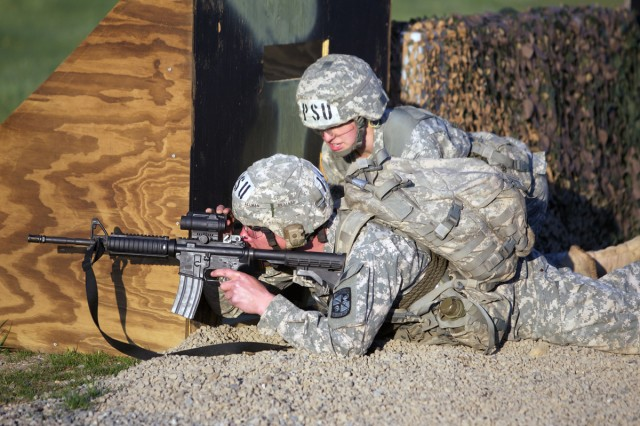 Penn State University Cadet Kate Bassett shouts instructions Friday to Taylor Moran as Moran aims at targets on the rifle range in the opening marksmanship event of the Sandhurst Competition at West Point, N.Y.