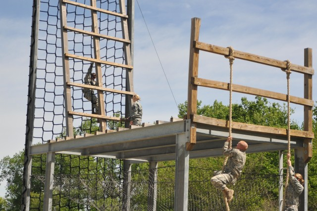 Cadets from the Black Hawk Brigade struggle through the Tough One obstacle, at the ROTC Joint-University Field Training Exercise, which was held April 12-15, 2012, at Fort Riley, Kan. Cadets were challenged to overcome obstacles to build confidence in themselves and each other.