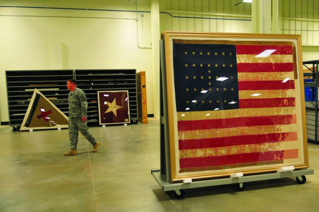 An early American flag, with only 37 stars, sits framed and mounted to keep from further decomposition at the Museum Support Center at Fort Belvoir, Va.