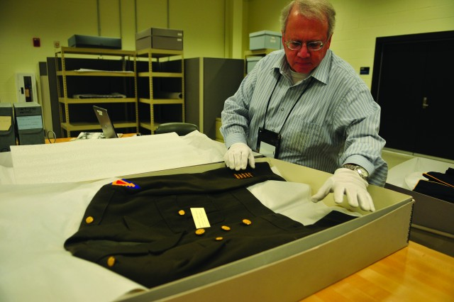 Alan Bogan, Museum Support Center curator, wears protective glove to keep from contaminating a new artifact before logging it into the center's data base, at the Museum Support Center at Fort Belvoir, Va.