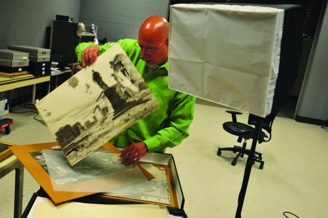 Pablo Jimenez, the Museum support Center's photographer, sorts through images before he mounts and documents them digitally, at the Museum Support Center at Fort Belvoir, Va.