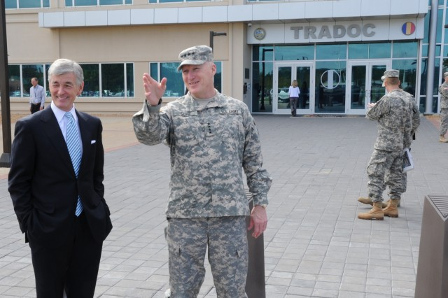 Secretary of the Army John McHugh and Gen. Robert W. Cone, commanding general of U.S. Army Training and Doctrine Command, engage in conversation as McHugh sets to depart the TRADOC Headquarters located at Joint Base Langley-Eustis, Va., April 20, 2012.