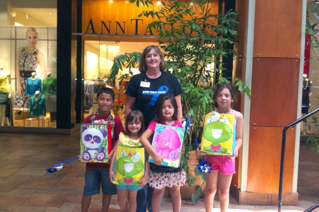 Ginny Wescott (back row), with the Family Advocacy Program; Army Community Service; Directorate of Family and Morale, Welfare and Recreation; U.S. Army Garrison-Hawaii; celebrates with winners of the Army's Child Abuse Prevention Month Poster Contest. Pictured, from left to right, are Devean Batres (Helemanu Elementary), 1st-3rd grade winner; Hailey Kahler (Helemanu Elementary), overall winner; Kelani Stewart (Helemanu Elementary), kindergarten winner; and Emily Cox (Fort Shafter Elementary School), 3rd-4th grade winner.