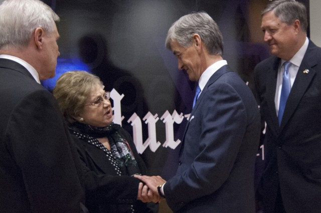 Secretary of the Army John McHugh shakes the hand of Holocaust survivor Charlene Schiff at the Department of Defense Holocaust Remembrance Day Observance April 19, 2012, at the Pentagon, Washington, D.C. In 1941, the Nazis invaded Schiff's hometown of Horochow, Poland, and set up a ghetto. In 1942, with rumors that the ghetto was about to be destroyed, she and her mother fled into the forest. After several days of evading capture, young Schiff woke to find her mother was gone. Schiff spent the rest of the war living in the forest and is the only survivor from her family. (U.S. Army photo by Spc. John G. Martinez)