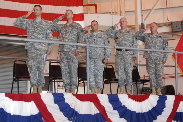 (L-R) 1st Sgt. Charles Reed, senior enlisted leader of Headquarters, Headquarters Company 411th Engineer Brigade, Capt. Brian Mykulak, commander Headquarters, Headquarters Company 411th Engineer Brigade, Command Sgt. Maj. Andrew Krom, senior enlisted leader 411th Engineer Brigade, Brig. Gen. Doug Satterfield, deputy commander 412th Theater Engineer Command, and Brig. Gen. David L. Weeks, commander, 411th Engineer Brigade, during the brigade headquarters' departure ceremony at Stewart Air National Guard Base, Newburg, N.Y. April 19, 2012. The group of Army Reserve Soldiers known as Task Force Empire will spend approximately a year in Afghanistan supporting the International Security Assistance Force Joint Command to improve security, development and governance.