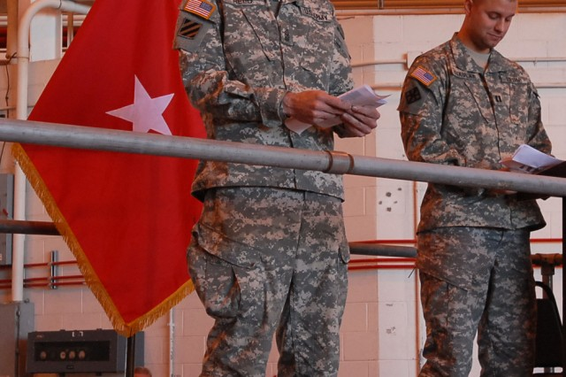 1st Sgt. Charles Reed, senior enlisted leader of Headquarters, Headquarters Company 411th Engineer Brigade, and the company commander Capt. Brian Mykulak, conduct a role call during the unit's departure ceremony at Stewart Air National Guard Base, Newburg, N.Y. April 19, 2012. The Army Reserve Soldiers known as Task Force Empire will spend approximately a year in Afghanistan supporting the International Security Assistance Force Joint Command to improve security, development and governance.