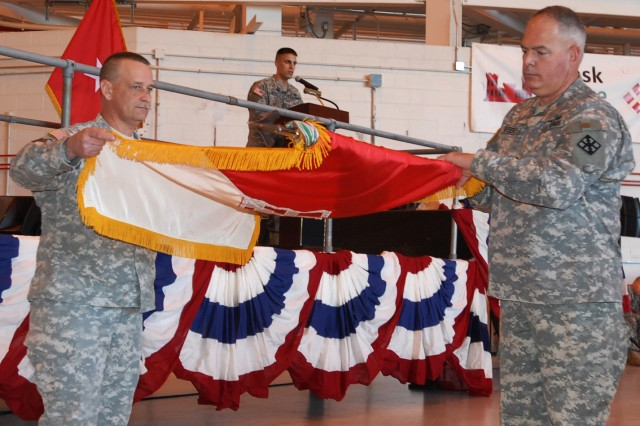 Command Sgt. Maj. Andrew Krom, senior enlisted leader 411th Engineer Brigade (L) and Brig. Gen. David L. Weeks, commander 411th Engineer Brigade, case the unit's colors during a departure ceremony at Stewart Air National Guard Base, Newburg, N.Y. April 19, 2012. The Army Reserve Soldiers known as Task Force Empire will spend approximately a year in Afghanistan supporting the International Security Assistance Force Joint Command to improve security, development and governance.